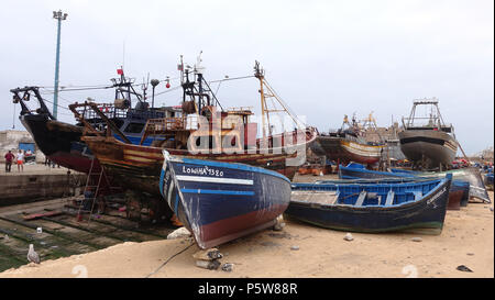 Fishing trawlers and boats in dock at Essaouira, Morocco. Some ready to be repaired and re-fitted. - Stock Image