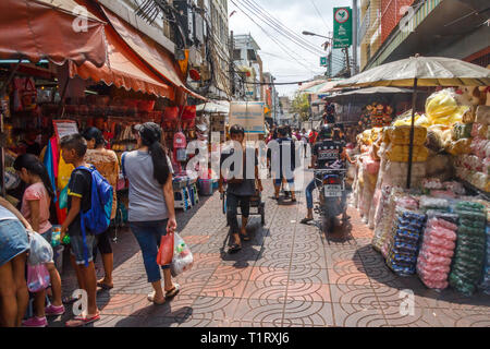 Bangkok, Thailand - 7th March 2017: Typical street scene in Chinatown. The area is bustling with shoppers. - Stock Image