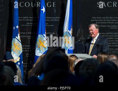 Col. (ret.) John Carney speaks during Tech. Sgt. John Chapman's name unveiling ceremony at the Air Force Memorial, in Arlington, Va., Aug. 24, 2018. Chapman was posthumously awarded the Medal of Honor for actions on Takur Ghar mountain in Afghanistan on March 4, 2002. An elite special operations team was ambushed by the enemy and came under heavy fire from multiple directions. Chapman immediately charged an enemy bunker through high-deep snow and killed all enemy occupants. Courageously moving from cover to assault a second machine gun bunker, he was injured by enemy fire. Despite severe wound - Stock Image