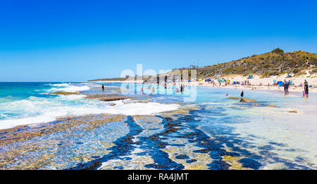 People at Yanchep Lagoon beach on a hot summer day. - Stock Image