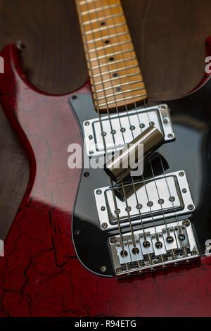 Slide guitar - electric guitar with a steel slide resting on the strings. - Stock Image