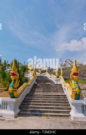 Staircase with golden naga sculptures, Wat Kaew, Krabi town, Thailand - Stock Image