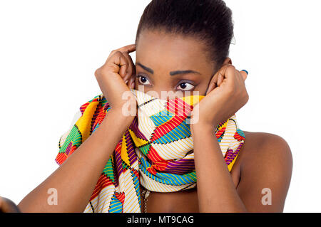 Fixed look of young African woman wanting to camouflage her face. - Stock Image
