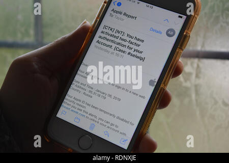 Spam / phishing email on smartphone, claiming to be from Apple, to induce owner to reveal personal information such as passwords & credit card details - Stock Image