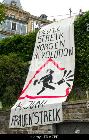 Banner calling for strike today, revolution tomorrow, displayed at the women's strike 14 June 2019, Zurich, Switzerland - Stock Image