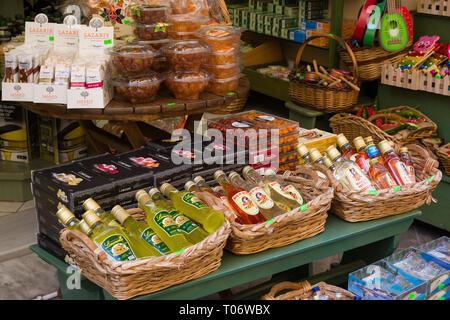 CORFU, GREECE - APRIL 7, 2018: A store that sales traditional for Corfu Island kumquat liqueur and kumquat fruits. Products from Corfu, Greece. - Stock Image