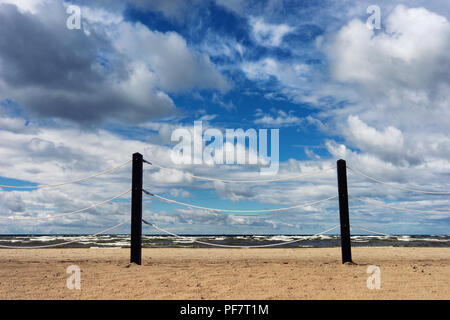 Rope fence on the beach of the Baltic Sea - Stock Image