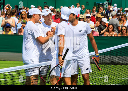 Tennis doubles handshake by British Players Ken and Neal Skrupski and Pakistani/Dutch duo Aisam-ul-Haq Qureshi and Jean-Julien Rojer at Wimbledon - Stock Image