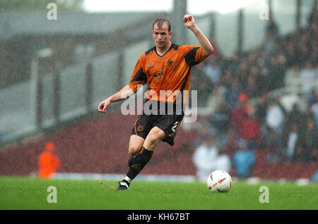 Footballer Mark Clyde playing heavy rain West Ham United v Wolverhampton Wanderers 02 October 2004 - Stock Image