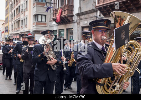 Tenerife, Canary Islands, a marching brass band plays during the Palm Sunday Holy Week procession through the streets of La Laguna. - Stock Image