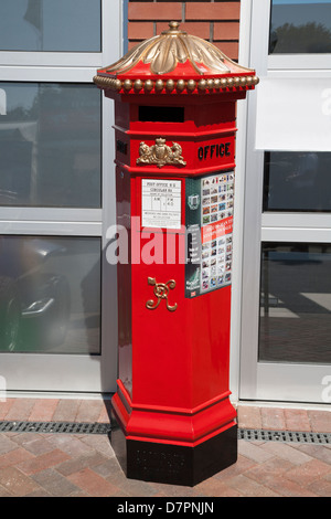 Victorian Penfold pillarbox,Isle of Man, at TT Grandstand. Isle of Man Post.Advert for Manx TT Stamps.Centenary - Stock Image