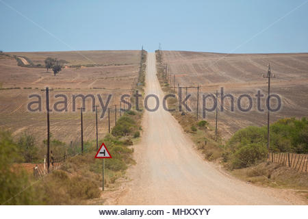 Straight Country Road Leading Through Arid South African Landscape - Stock Image