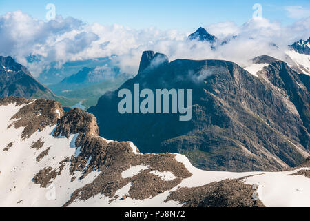Aerial view over mountains in Romsdalen, Møre og Romsdal, Norway.In center is the peak Romsdalshorn, and in the background is Store Vengetind. - Stock Image