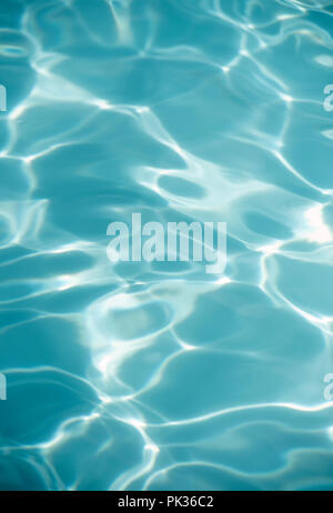 Abstract detail of sunlight reflecting off water in an outdoor swimming pool - Stock Image