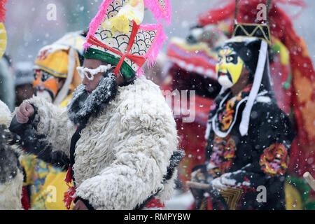 Xining, China's Qinghai Province. 16th Feb, 2019. Folk artists give a shehuo performance in Datong Hui and Tu Autonomous County, northwest China's Qinghai Province, Feb. 16, 2019. Shehuo performance in Qinghai is a time-honoured festivity during the celebration of Spring Festival in multiple forms such as dragon dance, stilt walking, yangge dance, lion dance and other folk performance. Credit: Wu Gang/Xinhua/Alamy Live News - Stock Image