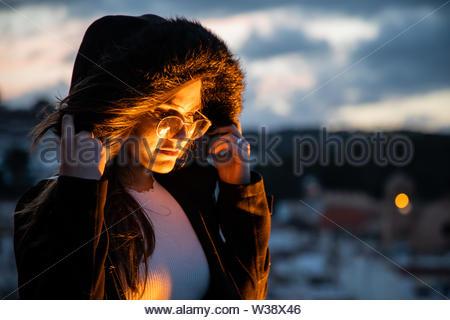 Beautiful women portrait lightened by orange light - Stock Image
