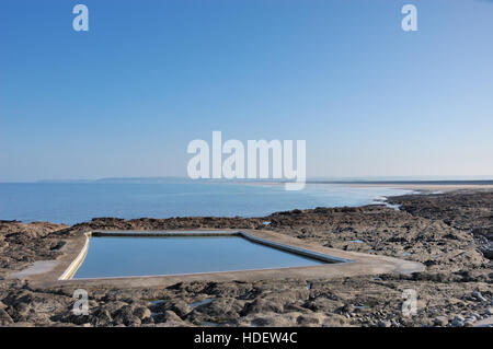 The tidal rock swimming pool at Westward Ho! on the North Devon coast. - Stock Image