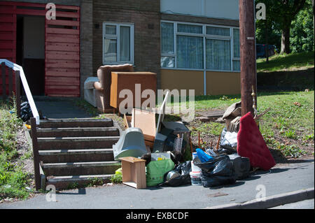 Dumped furniture fly-tipping on a street near flats in Dudley in the West Midlands, England, UK - Stock Image