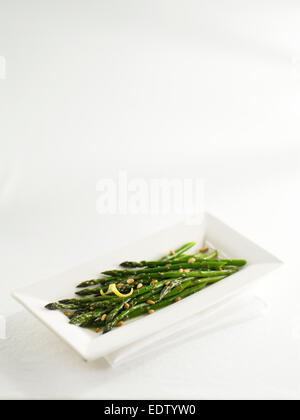 Asparagus in white plate - Stock Image