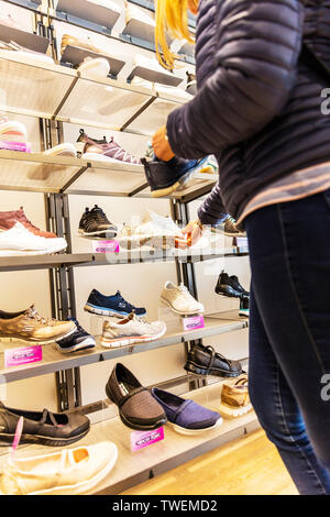 buying shoes, choosing shoes, shoe shopping, Skechers shoe shop, Skechers shoes, Skechers, Skechers shoe store, interior, inside, shoes, display, - Stock Image