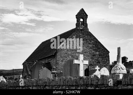 Little church with cemetery - Stock Image