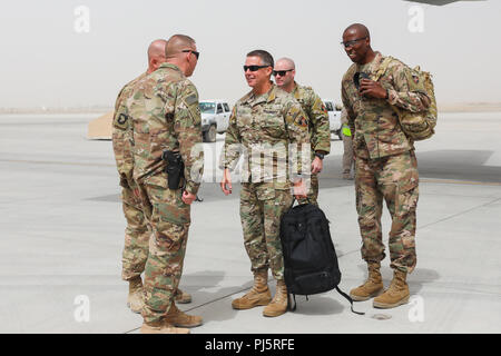 KANDAHAR AIRFIELD, Afghanistan (August 27, 2018) --- U.S. Army Command Sgt. Maj. Anton Hillig, senior enlisted leader for Train, Advise and Assist Command-South, greets U.S. Army Gen. Austin Miller, incoming Resolute Support /U.S. Forces-Afghanistan commander, August 27, 2018, at Kandahar Airfield, Afghanistan. Miller visited Kandahar Airfield to receive an overview of operations and organizational capabilities throughout the area. (U.S. Army photo by Staff Sgt. Neysa Canfield) - Stock Image