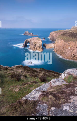 Dramatic cliffs, sea stacks and Enys Dodnan arch on the rugged north Atlantic coast, Lands End, Cornwall, UK - Stock Image