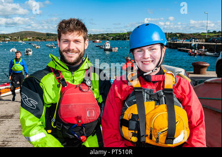 Schull, West Cork, Ireland. 6th Oct, 2018.  On a beautiful day in West Cork, Ciaran Lennon, Sligo and Rosie O'Sullivan, Cork prepare to go kayaking. Today's activities culminate this evening in a dinner dance at the Schull Harbour Hotel. Credit: Andy Gibson/Alamy Live News. - Stock Image
