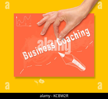 A hand picking up a Budget concept on a colorful drawing board. - Stock Image