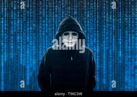 Hooded computer hacker with white mask - Stock Image