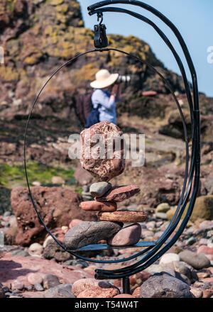 Dunbar, East Lothian, Scotland, UK. 21st Apr 2019. European stone stacking championship:  Balanced stones  at Eye Cave beach on the second day which comprises 2 competitions, a 3 hour artistic challenge and a children's competition. The overall winner receives a trip to llano Earth Art Festival & World Stone Balancing competition in Texas in 2020. Credit: Sally Anderson/Alamy Live News - Stock Image