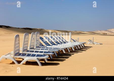 Row of empty sunbeds on a quiet white sand beach. Praia de Chaves, Rabil, Boa Vista, Cape Verde Islands, Africa - Stock Image