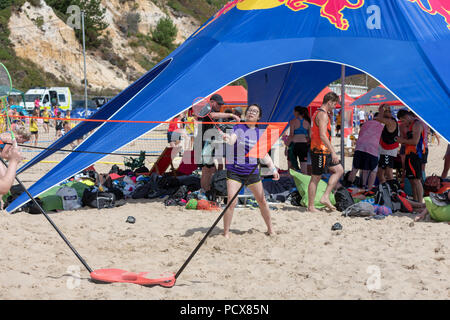 Bournemouth, UK. 4th August 2018. Over 40 teams from across Europe take part in the British Beach Handball Championships on Branksome Beach in Bournemouth as the heatwave carries on in to August 2018. The event is now in its sixth year. Credit: Thomas Faull/Alamy Live News - Stock Image