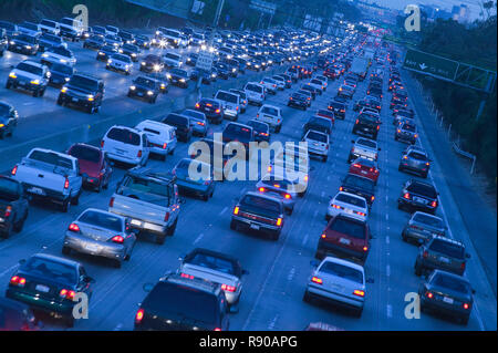 Aerial view of cars on freeway traffic with one car going in th oppostie direction. - Stock Image