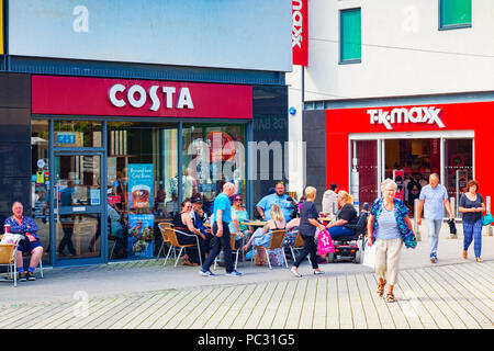 11 June 2018: St Austell, Cornwall, UK - Costa Coffee Shop, with a group of people sitting outside. - Stock Image