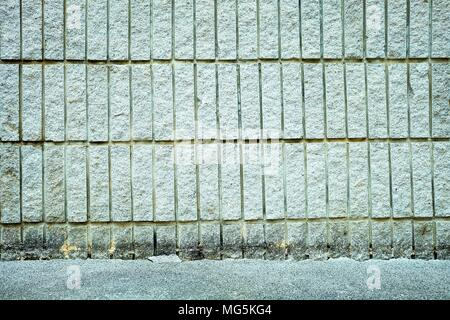 Concrete Wall with Pavement Background. - Stock Image