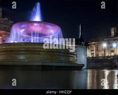 Fountain at night in Trafalgar Square with The National Gallery - Stock Image