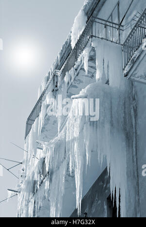 stalactites hanging from the balcony in winter - Stock Image