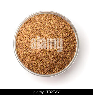 Top view of alfalfa seeds in glass bowl isolated on white - Stock Image