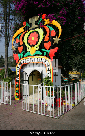 A Small Religious Shrine by the Entrance to the Canals of the Floating Gardens of Xochimilco Mexico City - Stock Image