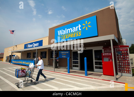 A woman exits a Walmart Express store in Gentry, Arkansas, U.S.A. - Stock Image