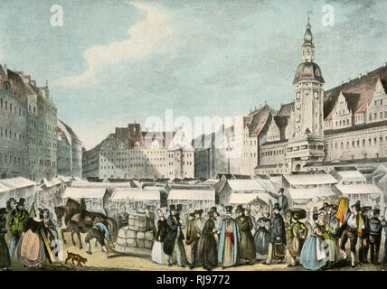 A busy scene at Leipzig fair as people mill around the stalls. - Stock Image