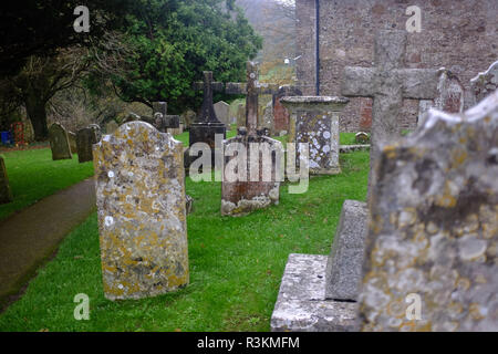 Graveyard at the church at Branscpmbe village in East Devon UK - Stock Image