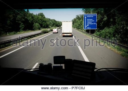 Truck driver view through the windscreen, heading north on the A3 autobahn in Germany. - Stock Image