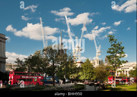 construction cranes and cheapside church from st pauls cathedral on a sunny day - Stock Image