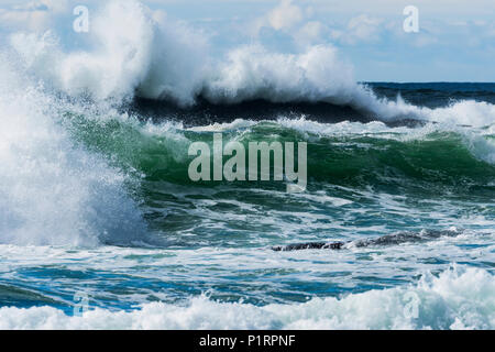 Surf breaks in the clouds; Newport, Oregon, United States of America - Stock Image
