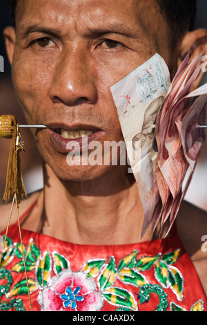 Thailand, Ko Phuket, Phuket.  A Ma-Thong (spirit medium) with cheeks pierced with a metal skewer, as an act of religion - Stock Image