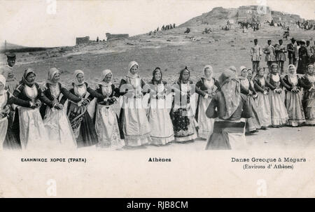 Women in traditional costume, dancing at Megara, near Athens, Greece. - Stock Image