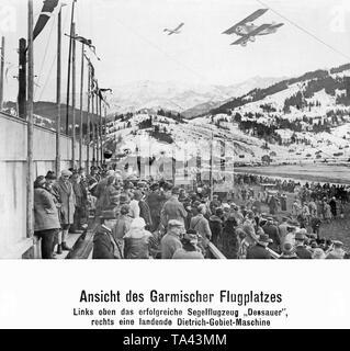 A Dietrich-Gobiet DP IIa flies over the airfield in Garmisch. Above the Dietrich-Gobiet biplane is the glider 'der Dessauer'. - Stock Image