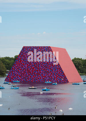 The London Mastaba is a temporary installation constructed on the Serpentine in Hyde Park by artist Christo. - Stock Image